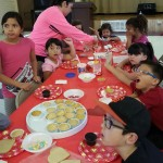 Children decorating pastries